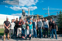 A group of tourists Chernobyl zone near the Chernobyl NPP on an excursion